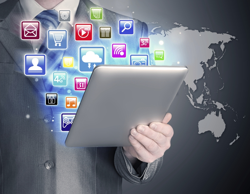 Business Application - man using tablet with colorful icons